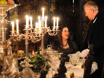 A silver service meal being served in festive decorated Rockingham Castle